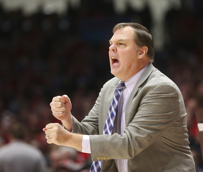 Fordham head coach Jeff Neubauer reacts during the first half of an NCAA college basketball game against Dayton, Saturday, Feb. 1, 2020, in Dayton, Ohio. (AP Photo/Tony Tribble)