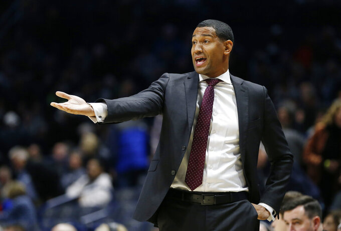 Missouri State head coach Dana Ford directs his team against Xavier during the first half of an NCAA college basketball game, Friday, Nov. 15, 2019, in Cincinnati. (AP Photo/Gary Landers)