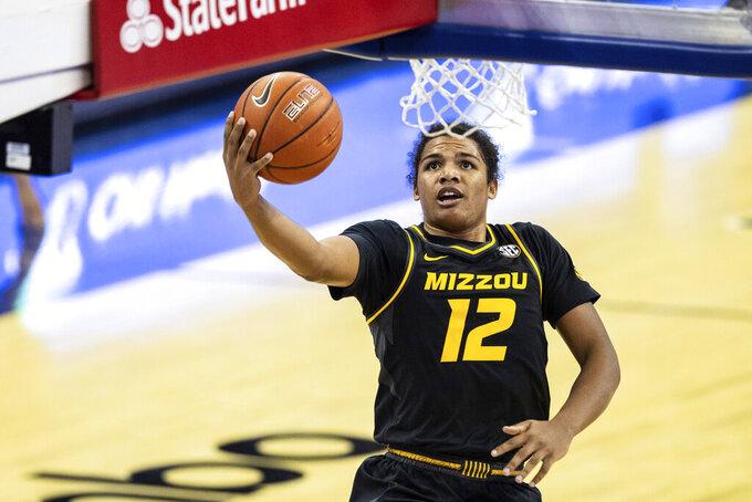 Missouri's Dru Smith shoots the ball against Oregon during an NCAA college basketball game, Wednesday, Dec. 2, 2020 in Omaha, Neb. (Chris Machian/Omaha World-Herald via AP)