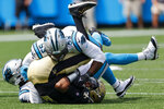 New Orleans Saints quarterback Jameis Winston is sacked by Carolina Panthers defensive end Brian Burns (53) and outside linebacker Haason Reddick during the first half of an NFL football game Sunday, Sept. 19, 2021, in Charlotte, N.C. (AP Photo/Nell Redmond)