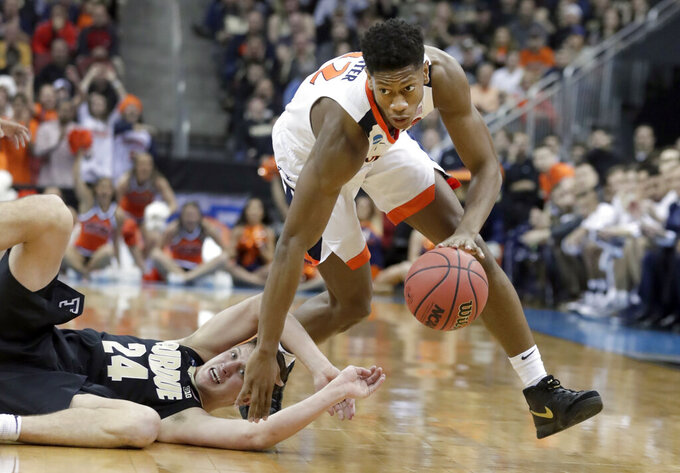 FILE - In this March 30, 2019, file photo, Virginia's De'Andre Hunter dribbles past Purdue's Grady Eifert (24) during the first half of the men's NCAA Tournament in Louisville, Ky. Although this year's Final Four is being touted as one in which experience and teamwork won out over raw talent, three of the teams in Minneapolis this week possess that young NBA talent, including Virginia and Texas Tech. (AP Photo/Michael Conroy, File)
