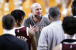 Mississippi State head coach Ben Howland talks to his players during a win over Vanderbilt in the second half of an NCAA college basketball game Saturday, Jan. 9, 2021, in Nashville, Tenn. (AP Photo/Mark Humphrey)