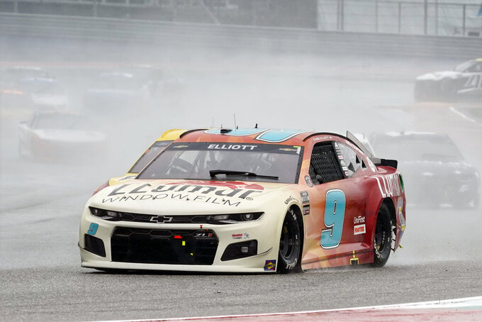 Chase Elliott (9) leads cars into Turn 13 during a NASCAR Cup Series auto race at Circuit of the Americas in Austin, Texas, Sunday, May 23, 2021. (AP Photo/Chuck Burton)