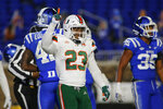 Miami running back Cam'Ron Harris (23) celebrates his touchdown against Duke during the second half of an NCAA college football game Saturday, Dec. 5, 2020, in Durham, N.C. (Nell Redmond/Pool Photo via AP)
