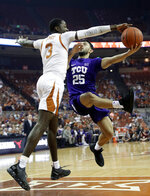TCU guard Alex Robinson (25) is blocked by Texas guard Courtney Ramey (3) as he drives to the basket during the first half of an NCAA college basketball game, Saturday, March 9, 2019, in Austin, Texas. (AP Photo/Eric Gay)