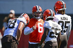 Cleveland Browns quarterback Baker Mayfield (6) calls a play in the huddle as Harrison Bryant, Demetric Felton and David Njoku listen during an NFL football practice in Berea, Ohio, Tuesday, Aug. 24, 2021. (AP Photo/David Dermer)