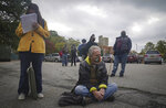 Voters wait in lines stretching blocks to cast their ballots during early voting at the Brooklyn Museum, Tuesday Oct. 27, 2020, in New York. (AP Photo/Bebeto Matthews)