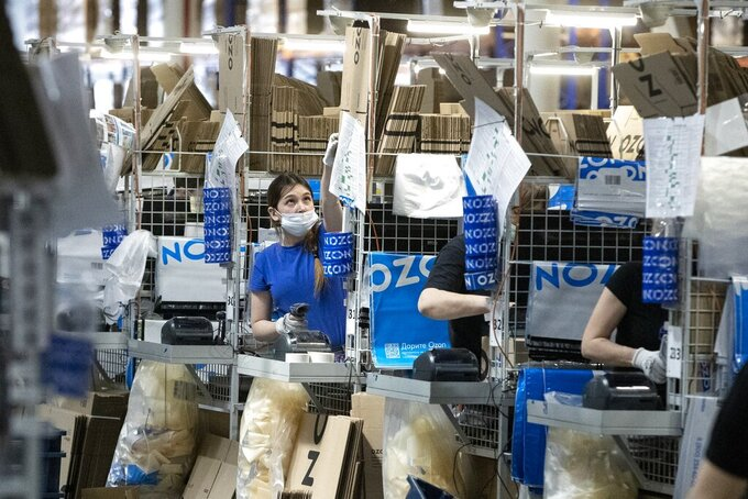 Employees work at Ozon, a major Russian e-commerce platform similar to Amazon, in Moscow, Russia, Thursday, March 25, 2021. Ozon saw sales jump nearly 2.5 times last year, the company's communications director Maria Zaikina said.  (AP Photo/Pavel Golovkin)