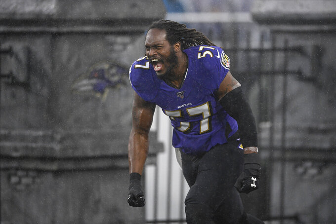 Baltimore Ravens middle linebacker Josh Bynes is introduced onto the field prior to an NFL football game against the Pittsburgh Steelers, Sunday, Dec. 29, 2019, in Baltimore. (AP Photo/Nick Wass)