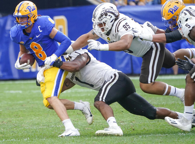 Western Michigan defensive linemen Ali Fayad (1) and Kainoa Fuiava (95) chase down and sack Pittsburgh quarterback Kenny Pickett (8) during the second half of an NCAA college football game, Saturday, Sept. 18, 2021, in Pittsburgh. Western Michigan won 44-41. (AP Photo/Keith Srakocic)