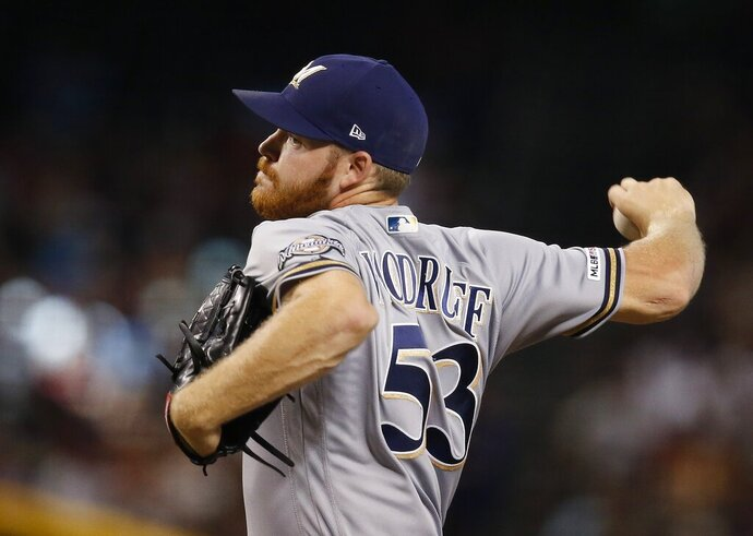 Milwaukee Brewers starting pitcher Brandon Woodruff throws against the Arizona Diamondbacks during the third inning of a baseball game Sunday, July 21, 2019, in Phoenix. (AP Photo/Ross D. Franklin)