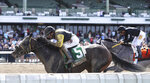 In this photo provided by Equi-Photo, 57-year-old jockey Jose Ferrer rides 79-1 longshot Informative (5) to victory in the Salvator Mile at Monmouth Park Racetrack in Oceanport, N.J., Tuesday, June 12, 2021.  At right, is Traffic (7), Paco Lopez up, who finished second. (Bill Denver/Equi-Photo via AP)