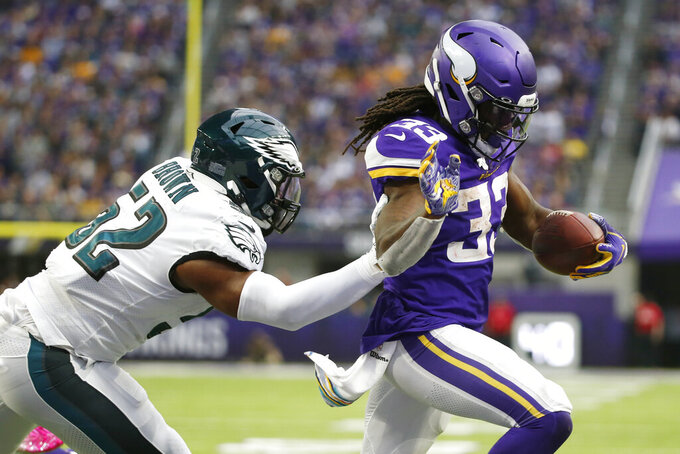 Minnesota Vikings running back Dalvin Cook scores on a 1-yard touchdown run ahead of Philadelphia Eagles inside linebacker Zach Brown, left, during the second half of an NFL football game, Sunday, Oct. 13, 2019, in Minneapolis. (AP Photo/Bruce Kluckhohn)