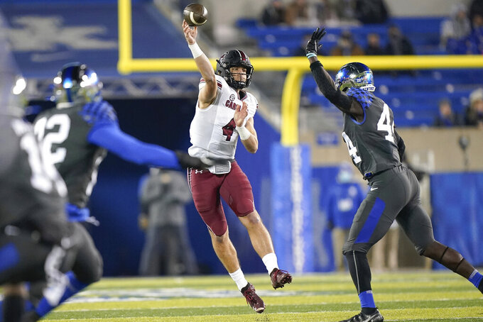 South Carolina quarterback Luke Doty (4) throws a pass during the second half of the team's NCAA college football game against Kentucky, Saturday, Dec. 5, 2020, in Lexington, Ky. (AP Photo/Bryan Woolston)