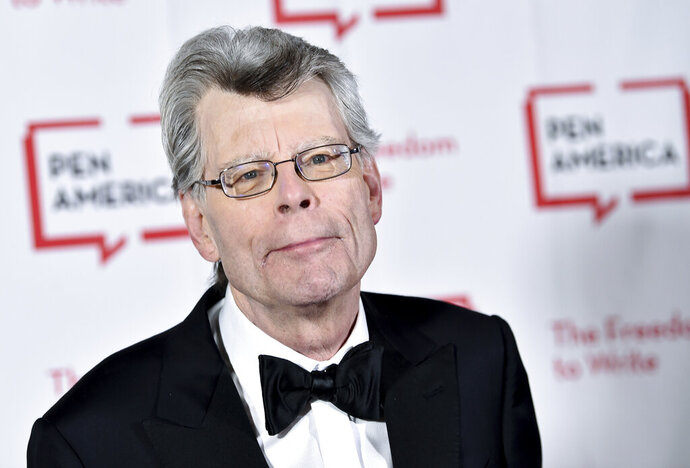FILE - This May 22, 2018 file photo shows Stephen King at the 2018 PEN Literary Gala in New York. With independent bookstores shut down nationwide, a new online seller is offering help. In January, Andy Hunter launched Bookshop.org.  Simon & Schuster is adding buy buttons for Bookshop.org to all of its websites and promoting Bookshop through emails and elsewhere online. It also has enlisted numerous authors, among them Stephen King, Susan Orlean and Jason Reynolds, to get the word out about Bookshop on social media and elsewhere. (Photo by Evan Agostini/Invision/AP, File)
