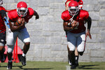 Georgia running back Zamir White (3) and Georgia running back D'Andre Swift (7) run a drill together during an NCAA football preseason practice in Athens, Ga., on Thursday, Aug. 15, 2019. [Photo/Joshua L. Jones, Athens Banner-Herald]/Athens Banner-Herald via AP)
