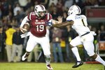 South Carolina quarterback Jake Bentley (19) runs with the ball against Chattanooga defensive back Brandon Dowdell (1) during the first half of an NCAA college football game Saturday, Nov. 17, 2018, in Columbia, S.C. (AP Photo/Sean Rayford)