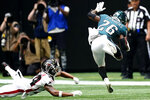 Philadelphia Eagles running back Miles Sanders (26) runs against the Atlanta Falcons during the second half of an NFL football game, Sunday, Sept. 12, 2021, in Atlanta. (AP Photo/John Bazemore)