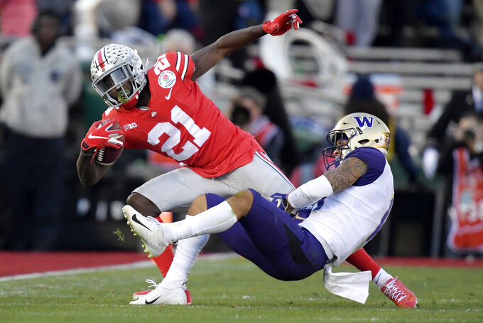 Ohio State wide receiver Parris Campbell is tackled by Washington defensive back Brandon McKinney during the first half of the Rose Bowl NCAA college football game Tuesday, Jan. 1, 2019, in Pasadena, Calif. (AP Photo/Mark J. Terrill)