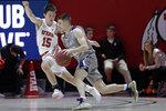 UC Davis guard Joe Mooney (22) drives as Utah guard Rylan Jones (15) defends during the second half of an NCAA college basketball game Friday, Nov. 29, 2019, in Salt Lake City. (AP Photo/Rick Bowmer)