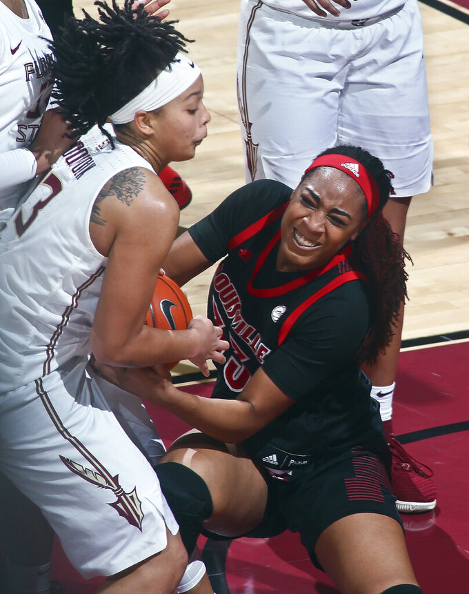 Florida State guard Nausia Woolfolk (13) and Louisville forward Bionca Dunham (33) fight for control of the ball during the first half of an NCAA college basketball game in Tallahassee, Fla., Thursday, Jan. 24, 2019. (AP Photo/Phil Sears)