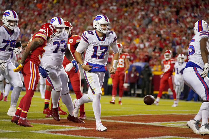 Buffalo Bills quarterback Josh Allen (17) celebrates after scoring during the first half of an NFL football game against the Kansas City Chiefs Sunday, Oct. 10, 2021, in Kansas City, Mo. (AP Photo/Charlie Riedel)