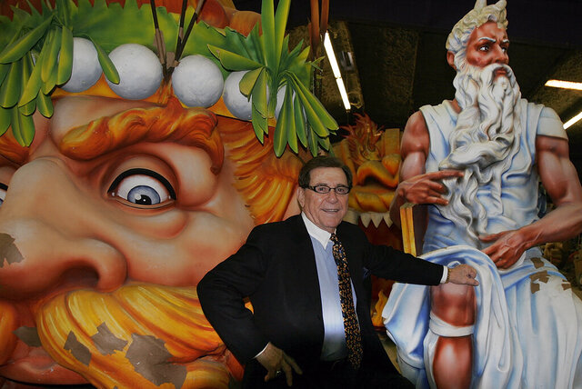 "FILE - In this Feb. 7, 2007 file photo, Blaine Kern, Sr. poses for a photograph with some of the creations he built for Mardi Gras floats in New Orleans.  The man known as ""Mr. Mardi Gras"