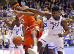 Duke's Zion Williamson (1) and Syracuse's Paschal Chukwu (13) chase a rebound during the first half of an NCAA college basketball game in Durham, N.C., Monday, Jan. 14, 2019. (AP Photo/Gerry Broome)