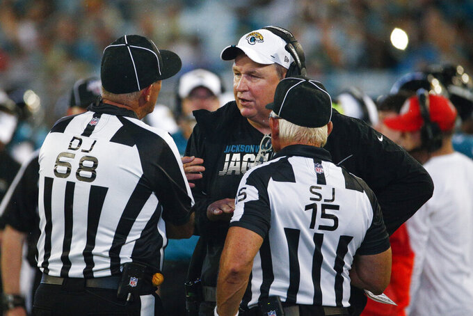 Jacksonville Jaguars coach Doug Marrone, center, has words with down judge Tom Stephan (68) and side judge Rick Patterson (15) during the second half of the team's NFL preseason football game against the Philadelphia Eagles, Thursday, Aug. 15, 2019, in Jacksonville, Fla. (AP Photo/Stephen B. Morton)