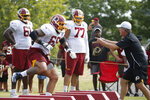 Washington Redskins offensive lineman, Hugh Thornton (69) runs drills as he is directed by offensive line coach Bill Callahan, right, during NFL football training camp in Richmond, Va., Wednesday, July 31, 2019. Thornton was signed Wednesday. (AP Photo/Steve Helber)