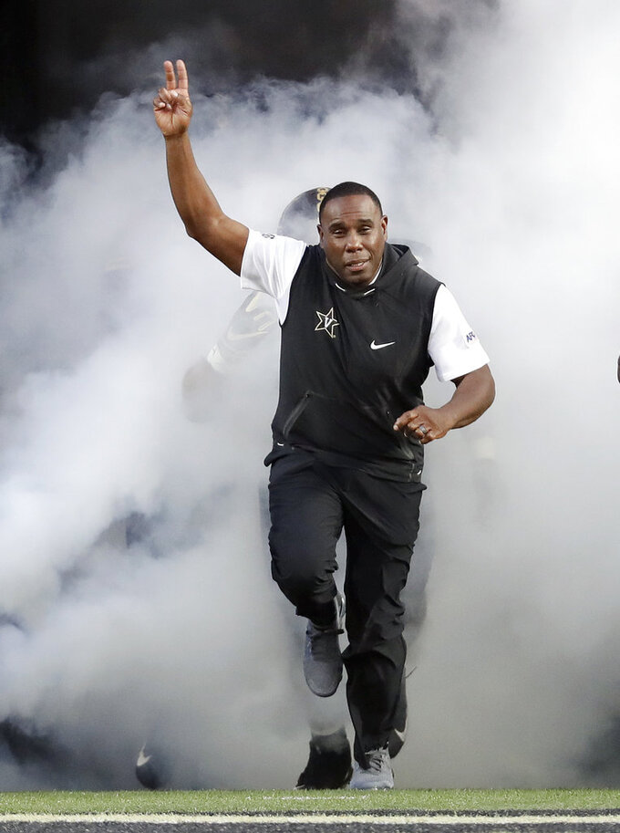 FILE - In this Sept. 2, 2018, file photo, Vanderbilt head coach Derek Mason leads his team onto the field before the start of an NCAA college football game against Middle Tennessee, in Nashville, Tenn. While at least one coach has been fired already in each of the other Power Five conferences, the SEC doesn't have anyone on an obvious hot seat heading into the final weekend of the regular season. Barring a surprise move, 2019 would mark the first time since 2006 that the SEC begins a season with no new head coaches. (AP Photo/Mark Humphrey, File)