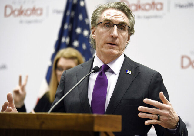 FILE - In this April 10, 2020, file photo, North Dakota Gov. Doug Burgum speaks at the state Capitol in Bismarck, N.D. Hospitalizations from COVID-19 have hit their highest points recently throughout the Midwest, where the growth in new cases has been the worst in the nation. Doug Burgum, North Dakota's Republican governor, acknowledges his state's numbers are moving in the wrong direction as it hit new highs for active and newly confirmed cases, as well as hospitalizations. But he's also touting the state's test positivity staying in the 7% range.(Mike McCleary/The Bismarck Tribune via AP, File)