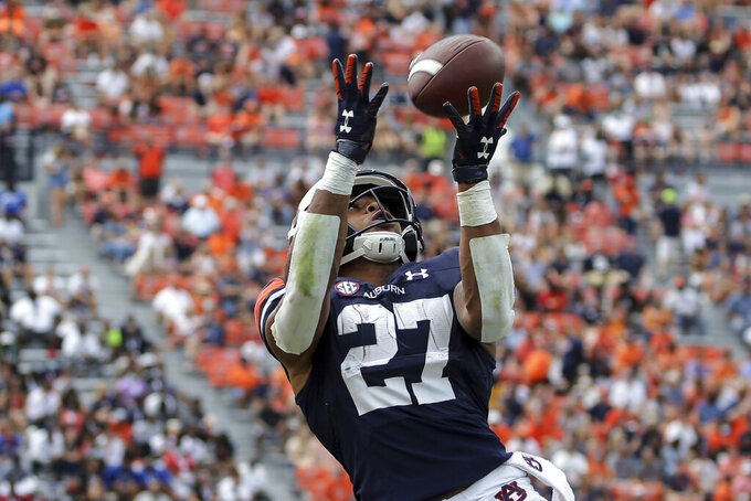 Auburn running back Jarquez Hunter (27) catches a pass against Alabama State during the first half of an NCAA football game Saturday, Sept. 11, 2021, in Auburn, Ala. (AP Photo/Butch Dill)