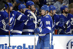 Tampa Bay Lightning defenseman Mikhail Sergachev (98) celebrates with the bench after his goal against the Pittsburgh Penguins during the first period of an NHL hockey game Thursday, Feb. 6, 2020, in Tampa, Fla. (AP Photo/Chris O'Meara)