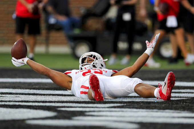 Houston running back Kyle Porter reacts after scoring a touchdown during the first half of an NCAA college football game against Cincinnati, Saturday, Nov. 7, 2020, in Cincinnati. (AP Photo/Aaron Doster)