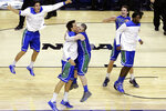FILE - In this March 22, 2013, file photo, Florida Gulf Coast players celebrate after winning a second-round game against Georgetown, 78-68, in the NCAA college basketball tournament in Philadelphia. They remain the biggest party crashers in tournament history, not just because of their seeding but also because they were in only their second season of full Division I eligibility.(AP Photo/Matt Slocum, File)
