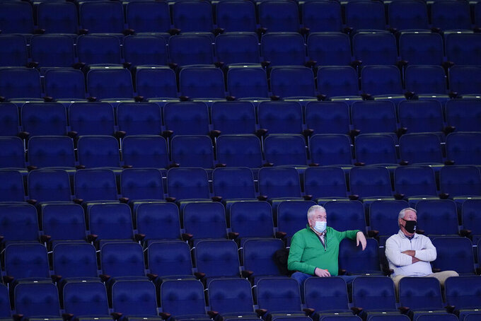 Fans watch during the second half of an NCAA college basketball game between Butler and Creighton in the Big East conference tournament Thursday, March 11, 2021, in New York. (AP Photo/Frank Franklin II)