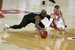 Michigan State's Joshua Langford, left, and Ohio State's Justin Ahrens fight for a loose ball during the first half of an NCAA college basketball game Sunday, Jan. 31, 2021, in Columbus, Ohio. (AP Photo/Jay LaPrete)