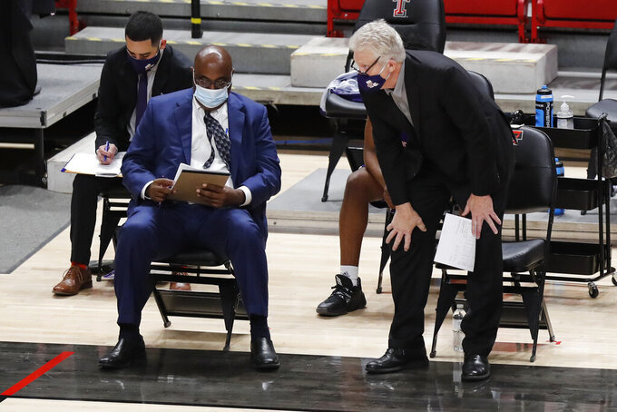 Northwestern State head coach Mike McConathy watches play from the bench in the first half of an NCAA college basketball game against Texas Tech, Wednesday Nov. 25, 2020, in Lubbock, Texas. (AP Photo/Mark Rogers)