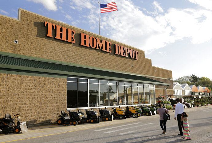 FILE - In this May 18, 2016, file photo, people approach an entrance to a Home Depot store in Bellingham, Mass. Wall Street expects another strong quarterly report card from Home Depot. Financial analysts predict the home-improvement retailer will report Tuesday, May 15, 2018, that its fiscal first-quarter results improved from a year earlier. That would be in line with Home Depot's results in the 12 months that ended in January. The company has benefited as more people invest in home remodeling amid a strong housing market. (AP Photo/Steven Senne, File)