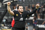 Las Vegas Raiders quarterback Derek Carr (4) celebrates after defeating the Baltimore Ravens in overtime in an NFL football game, Monday, Sept. 13, 2021, in Las Vegas. (AP Photo/Rick Scuteri)