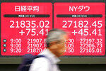 A man walks past an electronic stock board showing Japan's Nikkei 225 index at a securities firm in Tokyo Friday, Sept. 13, 2019. Stocks were broadly higher in Asia on Friday after gains overnight on Wall Street. Investors have stepped up buying on hopes for an easing of tensions in the costly trade war between the U.S. (AP Photo/Eugene Hoshiko)