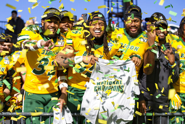 North Dakota State linebackers Jasir Cox (31), Aaron Mercadel (55), and Jabril Cox (42) celebrate after beating James Madison 28-20 in FCS championship NCAA college football game, Saturday, Jan. 11, 2020, in Frisco, Texas. (AP Photo/Sam Hodde)