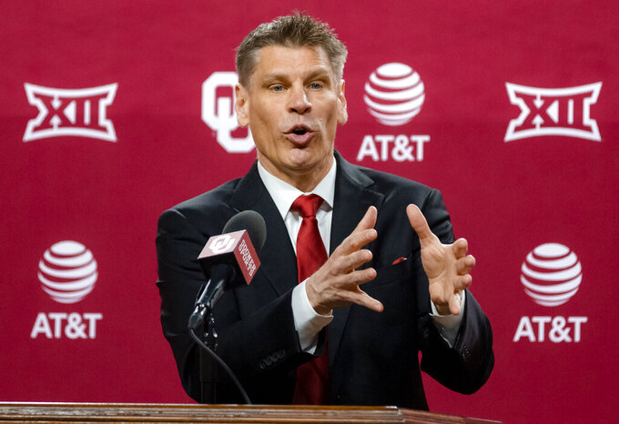 University of Oklahoma's new men's NCAA college basketball coach Porter Moser gestures during his introductory press conference at Lloyd Noble Center in Norman, Okla., Wednesday, April 7, 2021. (Chris Landsberger/The Oklahoman via AP)