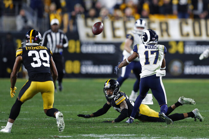 Pittsburgh Steelers free safety Minkah Fitzpatrick (39) prepares to intercept a pass intended for Los Angeles Rams wide receiver Robert Woods (17) during the second half of an NFL football game in Pittsburgh, Sunday, Nov. 10, 2019. (AP Photo/Keith Srakocic)