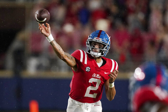 Mississippi quarterback Matt Corral (2) passes against Tulane during the first half of an NCAA college football game, Saturday, Sept. 18, 2021, in Oxford, Miss. (AP Photo/Rogelio V. Solis)