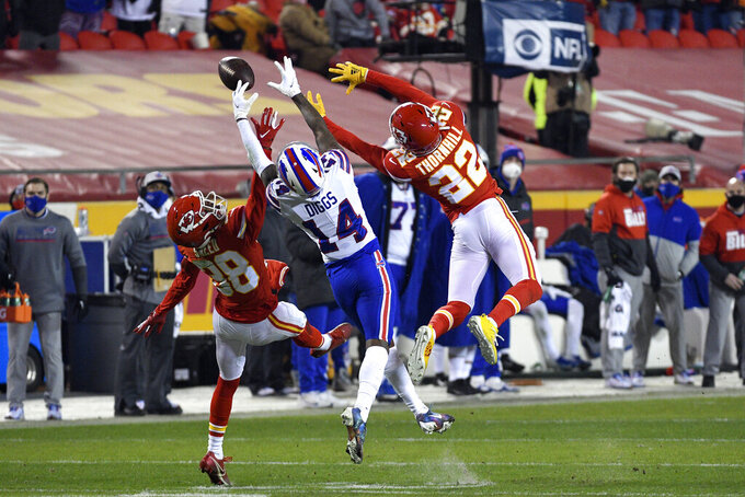 Kansas City Chiefs safety L'Jarius Sneed (38) and safety Juan Thornhill (22) break up pass intended for Buffalo Bills wide receiver Stefon Diggs (14) during the second half of the AFC championship NFL football game, Sunday, Jan. 24, 2021, in Kansas City, Mo. (AP Photo/Reed Hoffmann)