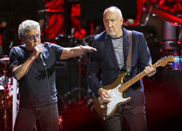 FILE- In this Sept. 18, 2019 file photo, Roger Daltrey, left, and Pete Townshend of The Who perform during the Moving On! Tour at State Farm Arena in Atlanta. The band postponed their UK and Ireland tour that was scheduled to start Monday and run through April 8 due to the new coronavirus outbreak. For most people, the new coronavirus causes only mild or moderate symptoms. For some it can cause more severe illness. (Photo by Robb Cohen/Invision/AP, File)