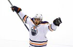 Edmonton Oilers center Leon Draisaitl celebrates a goal by defenseman Darnell Nurse against the Arizona Coyotes, during the third period of an NHL hockey game, Friday, Jan. 12, 2018, in Glendale, Ariz. The Oilers defeated the Coyotes 4-2. (AP Photo/Ross D. Franklin)