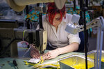 Jolee Masson, a Coker student and costume designer, volunteered to sew new elastic into medical masks at the Tara Grinna Swimwear factory Monday, March 30, 2020 in Conway. The factory has converted their operations from making custom swimsuits to sewing elastic into N95 masks in response to the coronavirus. Tidelands Health has delivered 35,000 of the masks that were held in storage with degraded elastic bands. The swimwear manufacturer's sewers, many of whom are at high risk for the virus, all volunteered to come back to work to complete the project along with help from volunteers within the community. March 30, 2020.  (Jason Lee/The Sun News via AP)